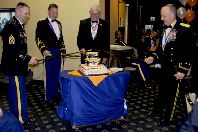 Aviation Branch Command Sgt. Maj. James H. Thomson; CW5 Michael L. Reese, chief warrant officer of the Aviation Branch; retired Lt. Gen. Ellis D. Parker; and Maj. Gen. Kevin W. Mangum, USAACE and Fort Rucker commanding general, cut the Army Aviation 30th birthday cake at the birthday ball April 19 at The Landing.