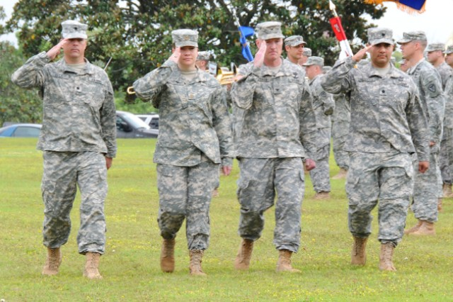 Lt. Col. Raymond J. Herrera (far right), 1st Bn., 212th Avn. Regt. commander, troops the line with Col. Kevin J. Christensen, 110th Avn. Bde. commander, Maj. Salamasinaleilani T. Strokin, 1st Bn., 212th Avn. Regt. executive officer, and Lt. Col. Ronald L. Ells, outgoing 1st Bn., 212th Avn. Regt. commander, during a change of command ceremony at Howze Field April 19.