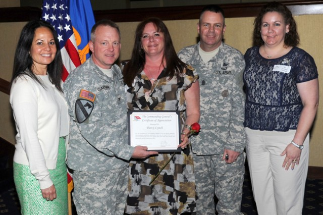 Darcy Lynch stands with Angel Mangum, wife of U.S. Army Aviation Center of Excellence and Fort Rucker commanding general Maj. Gen. Kevin W. Mangum; Col. Douglas Gabram, USAACE deputy commander, Aviation Branch Command Sgt. Maj. James H. Thomson Jr., and Jennifer Thomson as she accepts her Fort Rucker 2012 Lifetime Achievement Award during the Volunteer Appreciation Ceremony April 22 at The Landing.