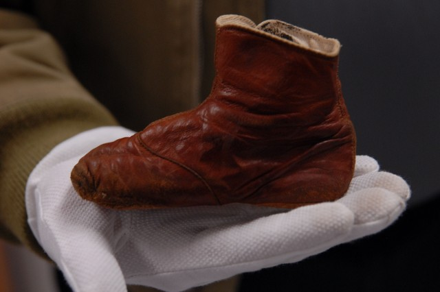 The baby shoe that was worn by Patton when he was about 10 to 11 months old. The shoe dates back to 1886.