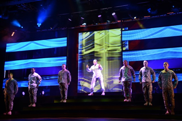 Spc. Felicia Holcomb (center) of Fort Gordon, Ga., performs with the 2013 U.S. Army Soldier Show on April 20 at Fort Sam Houston Theatre in San Antonio. Her younger sister, Amber Holcomb, is one of four finalists on American Idol.