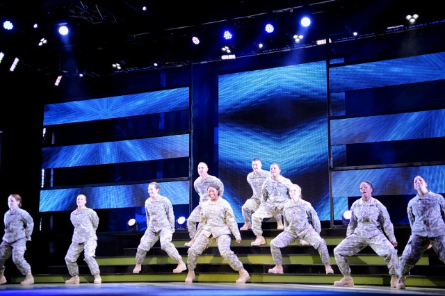 Spc. Felicia Holcomb (front and center) of Fort Gordon, Ga., performs with the 2013 U.S. Army Soldier Show. Her younger sister, Amber Holcomb, is one of four finalists on American Idol.