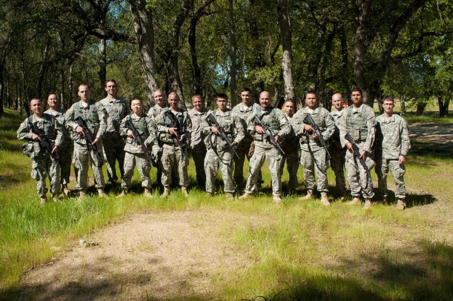 Competitors and their sponsors pose during the 2013 7th Psyop Group Best Warrior competition at Fort Hunter Liggett, Calif. The top noncommissioned officer and enlisted soldier will compete to be the USACAPOC(A) Best Warrior in a few weeks.
