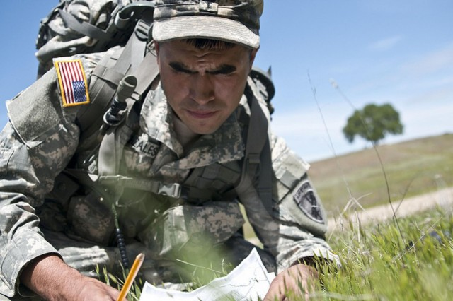 Spc. Samuel Gonzales plots a point on a map during the land navigation portion of the 7th Psychological Operations Group Best Warrior Competiton April 6, 2013, at Fort Hunter Liggett, Calif.