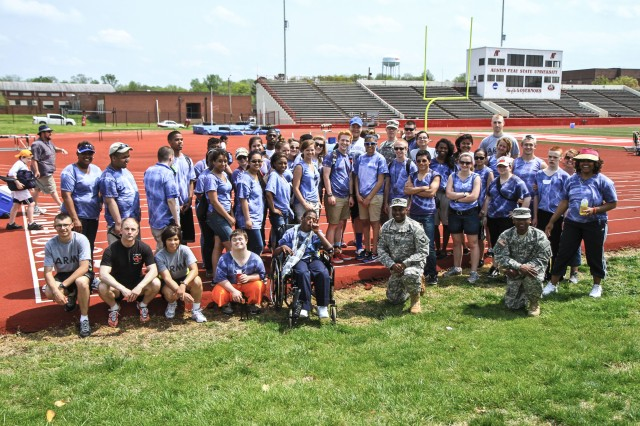 The volunteer Soldiers from the 526th Brigade Support Battalion, 2nd Brigade Combat Team, 101st Airborne Division (Air Assault) and the Fort Campbell High School student athletes and coaches, pose for a picture after the closing ceremonies of the Area 12 Special Olympics held at Clarksville's Austin Peay Stadium, April 18. The volunteer Soldiers provided donated food, beverages, pop-up tents and encouragement for the special needs athletes throughout the day long event. (US Army photo by Sgt. Keith Rogers, 2nd BCT UPAR, 101st Abn. Div.)