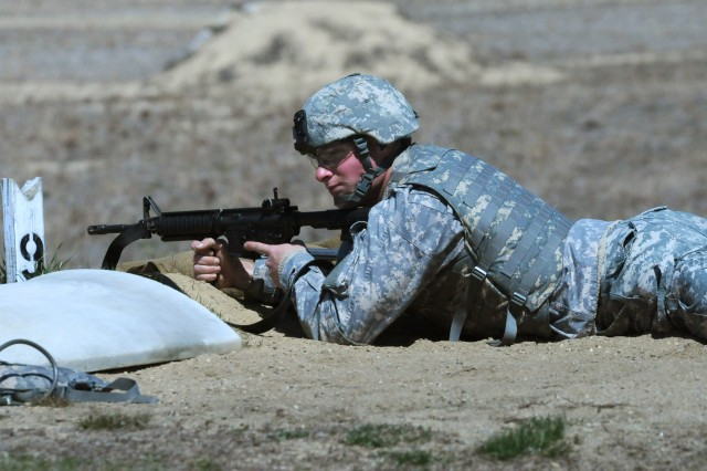 Spc. Matthew Hagy, 733th Engineer Company, 844th Engineer Battalion, 926th Engineer Brigade, waits in the prone, unsupported position, on the M4 rifle qualification range during the 412th Theater Engineer Command's 2013 Best Warrior Competition at Fort Devens, Mass. April 24.