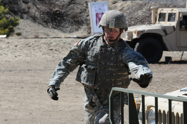 Sgt. Nicholas Waagmeester, 844th Engineer Battalion, 926th Engineer Brigade, runs to tag the Humvee at the final leg of the reflexive fire range after engaging targets with the M4 rifle and M9 pistol during the 412th Theater Engineer Command's 2013 Best Warrior Competition held at Fort Devens, Mass. April 24.