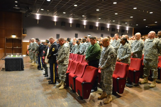 Many from the U.S. Army Garrison Ansbach community hold a moment of silence in reflection on the atrocities of the Holocaust during the garrison's Days of Remembrance Ceremony April 19 at Katterbach Theater at Bismarck Kaserne.
