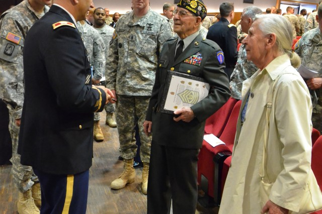 Col. Kelly J. Lawler, left, commander of U.S. Army Garrison Ansbach, talks to special guest retired Sgt. 1st Class Paul Parent following USAG Ansbach's Days of Remembrance ceremony April 19 at Katterbach Theater at Bismarck Kaserne. The ceremony remembered the Holocaust and focused on the events that led to it.