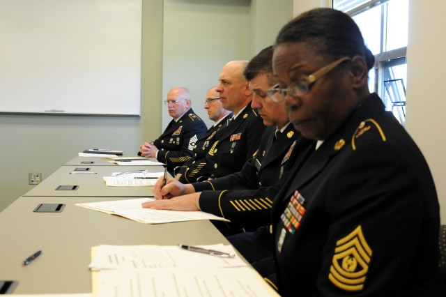A panel of sergeants major preside over the junior enlisted board portion of the 412th Theater Engineer Command's 2013 Best Warrior Competition and ask Soldiers questions on various subjects such as maps, weapons and current events at Fort Devens, Mass. April 25.