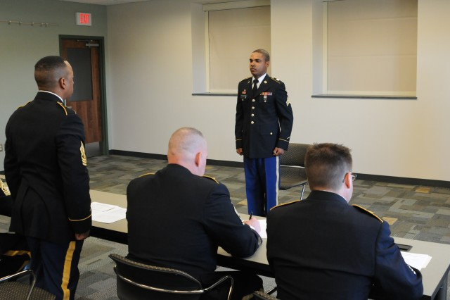 Sgt. Philip Lilavois, 854th Engineer Battalion, 411th Engineer Brigade, appears before a sergeants major panel during the senior enlisted board for the 412th Theater Engineer Command's 2013 Best Warrior Competition held at Fort Devens, Mass. April 25.