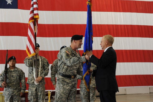 AMCOM Major General Lynn A. Collyar presents the CCAD flag to new Executive Director Mr. William L. Braddy. A Change of Executive Authority ceremony was held in Hangar 44, April 18.  Braddy will hold Executive Authority until incoming commander Col. Garner Pogue III assumes command in July.