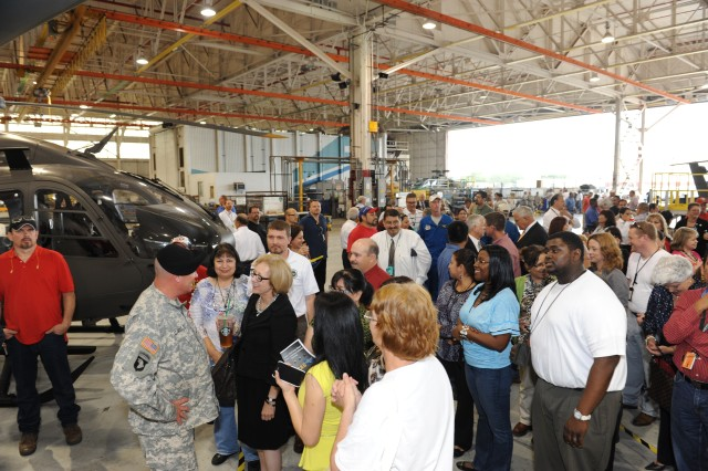 Crowds gather to speak to former Commander Col. Christopher B. Carlile before he leaves the Corpus Christi Army Depot for his next assignment. Employees regard him as the most sincere and approachable commander in the depot's history. To them, Col. Carlile will always represent true leadership.