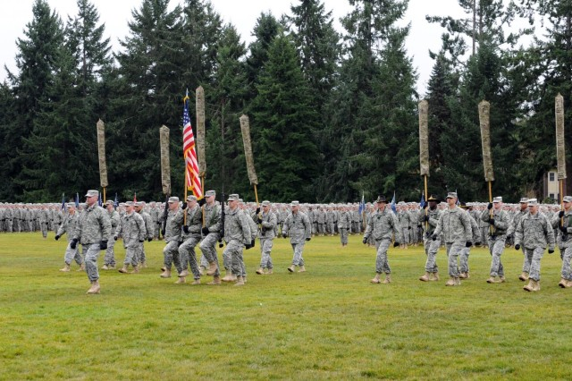 U.S. Soldiers from the 2nd Stryker Brigade Combat Team, 2nd Infantry Division, march the brigade colors to the center of Watkins Field during a redeployment and uncasing ceremony at Joint Base Lewis-McChord, Wash., Feb. 14, 2013. (U.S. Army photo by Sgt. Ryan Hallock/Released)