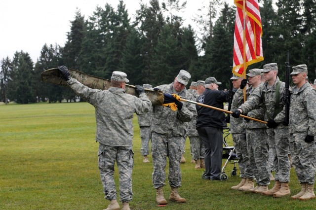 U.S. Army Col. Barry Huggins, 2nd Brigade Stryker Combat Team commander, and Command Sgt. Maj. Andrew Connette, brigade senior enlisted advisor, uncase the brigade colors at Joint Base Lewis-McChord, Wash., Feb. 14, 2013. (U.S. Army photo by Sgt. Ryan Hallock/Released)