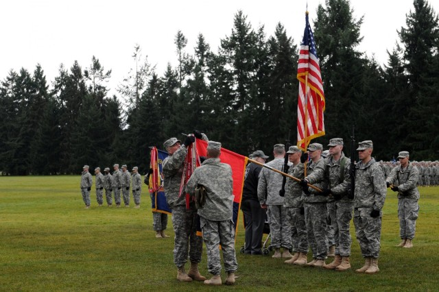 U.S. Army Col. Barry Huggins, 2nd Brigade Stryker Combat Team commander and Command Sgt. Maj. Andrew Connette, brigade senior enlisted adviser, uncase the brigade colors at Joint Base Lewis-McChord, Wash., Feb. 14, 2013. (U.S. Army photo by Sgt. Ryan Hallock/Released)