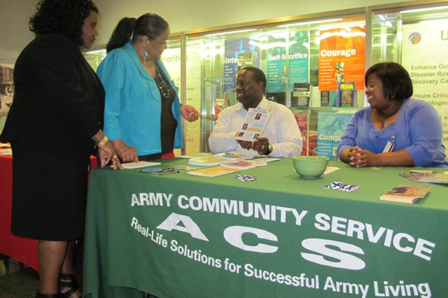 From left, Huntsville Center Equal Employment Opportunity employees Sonja Rice and Angela Morton receive information April 23 about sexual assault awareness and child abuse and neglect prevention from Army Community Service Sexual Assault and Domestic Violence Program victim advocates Perrar Joseph and Jeronica Frierson.