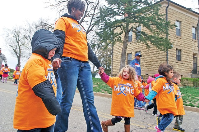 Sharon Rogers, program assistant, CYSS, second from left, leads her class in the MOMC Parade April 16 on Main Post, Fort Riley, Kan. About 300 children walked in the parade.