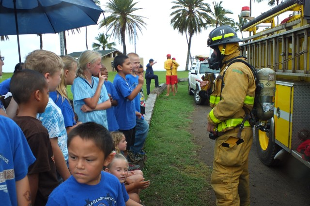 Second-graders see just how qucikly an HFD firefighter can suit up.