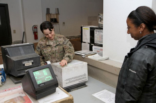 Sgt. Diana Arias-Cruz, custodian of postal effects, 444th Human Resource Company, tapes up a package for Brittany Bryant, Area 82 Information Management officer, at Bagram Air Field's post office April 23, 2013. The 444th is one of many Army Reserve units on post that celebrated the Reserve's 105th birthday April 25, 2013. The Reserve, which was founded April 23, 1908, as a reserve corps of medical personnel, now includes 148 different military occupation specialties and accounts for 20 percent of the Army's total force. (U.S. Army National Guard photo by Spc. Mark VanGerpen, 129th Mobile Public Affairs Detachment)