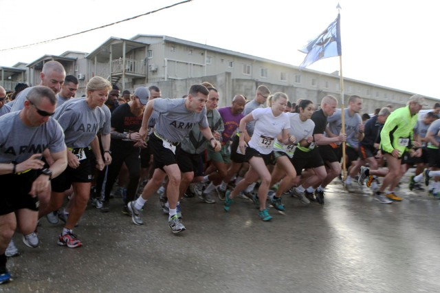 Runners take off at the start of a 5k run to celebrate the Army Reserve's 105th birthday at Bagram Air Field, April 25, 2013. Lt. Gen. Jeffery Talley, chief, Army Reserve and commanding general, United States Army Reserve Command, Chief Warrant Officer 5 Phyllis Wilson, command chief warrant officer, Army Reserve, and Command Sgt. Maj. James Lambert, interim command sergeant major, Army Reserve, visited Bagram Air Field to help fellow Reservists celebrate the day. The Reserve, which was founded April 23, 1908, as a reserve corps of medical personnel, now includes 148 different military occupation specialties and accounts for 20 percent of the Army's total force. (U.S. Army National Guard photo by Spc. Mark VanGerpen, 129th Mobile Public Affairs Detachment)
