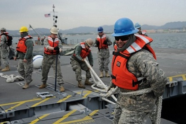 Soldiers of the 331st Transportation Company, 11th Transportation Battalion, 7th Sustainment Brigade, from Fort Eustis, Va., set up a modular causeway system in Pohang, South Korea, April 14, 2013. The 331st is working in support of the Combined Joint Logistics Over the Shore Exercise near Pohang, Republic of Korea. (U.S. Army photo by Sgt. Candace Le/Released)
