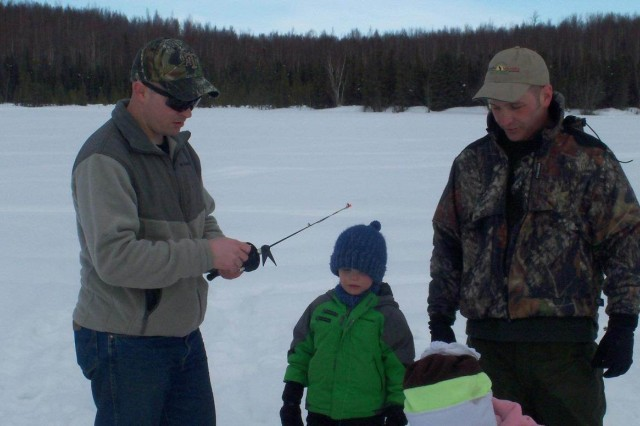 The Soldier Family Assistance Center organized an ice fishing trip for the Soldiers and family members. Nobody is too young for fishing in Alaska.