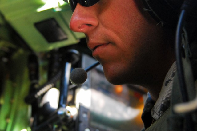 "Sgt. Chris Anderson, an Albuquerque, N.M. native and infantryman assigned to Company B, 2nd ""Lancer"" Battalion, 5th Cavalry Regiment, 1st ""Ironhorse"" Brigade Combat Team, 1st Cavalry Division, participates in Lancer's gunnery skills testing in a Bradley Fighting Vehicle April 24, at Fort Hood, Texas. (Photo by Pfc. Paige Pendleton, 1BCT Public Affairs, 1st Cav. Div.)"