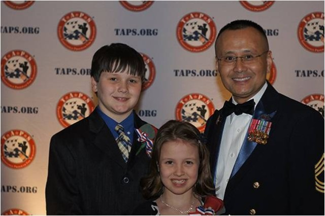 MSG Bill Arnold, Headquarters, U.S. Army Intelligence and Security Command (INSCOM), Chaplain NCOIC, with Jay and MacKenzie Stoddard,  children of a fallen service member.  The Stoddards provided the invocation for the 2013 TAPS Honor Gala.