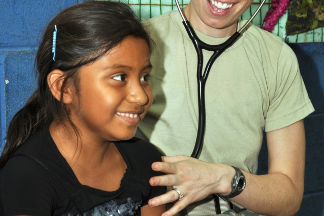 U.S. Air Force Capt. Alicia Catherine Prescott, a pediatrician with the 959th Medical Group, checks the vital signs of a Salvadoran child at a clinic during Beyond the Horizon in Guacamaya, El Salvador, April 26, 2013. Beyond the Horizon is a chairman of the Joint Chiefs of Staff-directed, U.S. Southern Command-sponsored joint and combined field training humanitarian exercise. (U.S. Army photo by Sgt. Richard Frost/Released)
