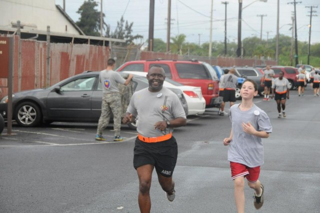 Soldiers and families of the 311th Signal Command and 516th Signal Brigade gathered on Ft. Shafter Flats for a run/walk in Honolulu, HI, Apr 22. The event was to help raise awareness for sexual assault prevention as April is Sexual Assault Awareness Month.