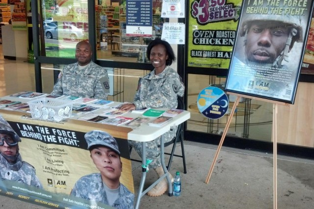 Master Sgt. Roberta Dawson, 311th Signal Command (Theater) SARC teamed with Sgt. 1st Class David Rhodes, 516th Signal Brigade SARC to hand out brochures, pamphlets, cards, and educate those who passed by their Community Awareness booth at the Fort Shafter Market Apr. 23-24.