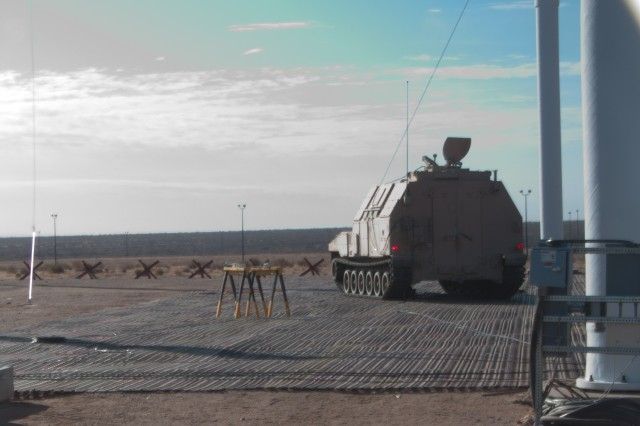 The Ammunition Supply Vehicle is exposed to a simulated nearby lightning strike. The arc captured in this photo is around 50,000 volts and produces a magnetic field that can damage or destroy unprotected electrical system.