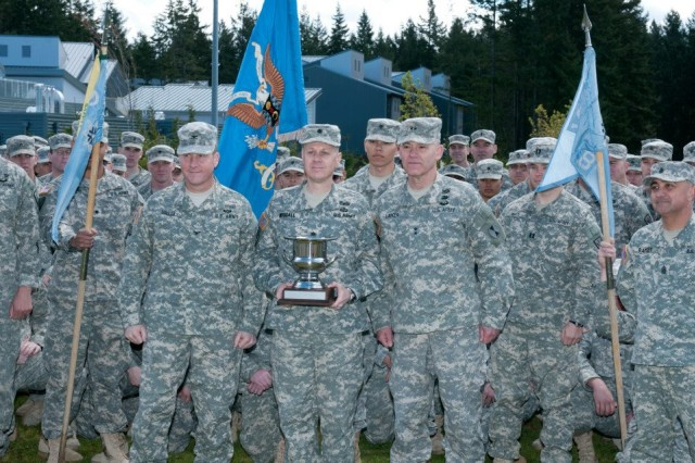 Maj. Gen. Stephen R. Lanza, commanding general, 7th Infantry Division, presented the Director's Trophy to Lt. Col. Douglas R Woodall, commander, 109th Military Intelligence Battalion, during a ceremony on Joint Base Lewis-McChord, Wash., April 29. The Directors Trophy is a prestigious award given annually by the Director of the National Security Agency. The 109th MI Bn Soldiers were recognized with the award for providing critical signals intelligence support while deployed to Regional Command East, Afghanistan. (U.S. Army Photo by Staff Sgt. David Chapman, 5th MPAD)