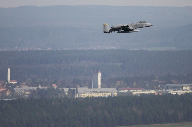 A U.S. Air Force A-10 Thunderbolt from the 81st Fighter Squadron, Spangdahlem Germany, makes a final flight over the Joint Multinational Training Command's Grafenwoehr Training Area, Apr 24, 2013.  In the background is the iconic Grafenwoehr Water Tower. The A-10 attack aircraft made its first flight over the Grafenwoehr Training Area on Aug. 25, 1977. (U.S. Army photo by Michael Beaton, JMTC Public Affairs / Released)