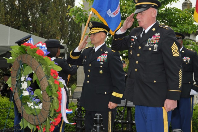 Brig. Gen. Edward M. Daly, Chief of Ordnance and Ordnance School commandant, and Command Sgt. Maj. Clinton G. Hall, Ordnance Corps regimental command sergeant major, salute the playing of taps April 28, during a wreath laying ceremony at the tomb of President James Monroe in Richmond's Hollywood Cemetery. To pay homage to the nation's leaders, ceremonies like this are held annually at the gravesites of each of the former presidents on their birthday.