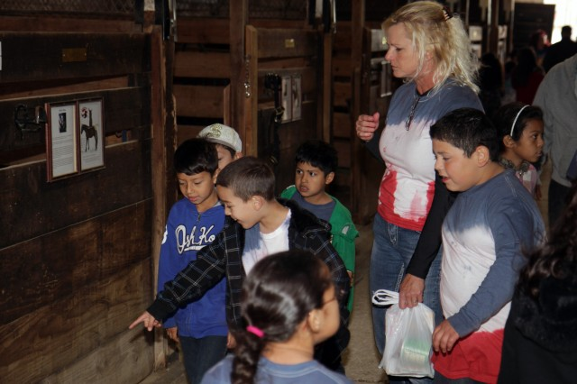 "FORT SAM HOUSTON, Texas ""Students and a teacher from Sun Valley Elementary School tour the U.S. Army North (Fifth Army) stables April 25 as part of a field trip. During the trip, the second-graders learned about caring for horses and the importance of Army values."