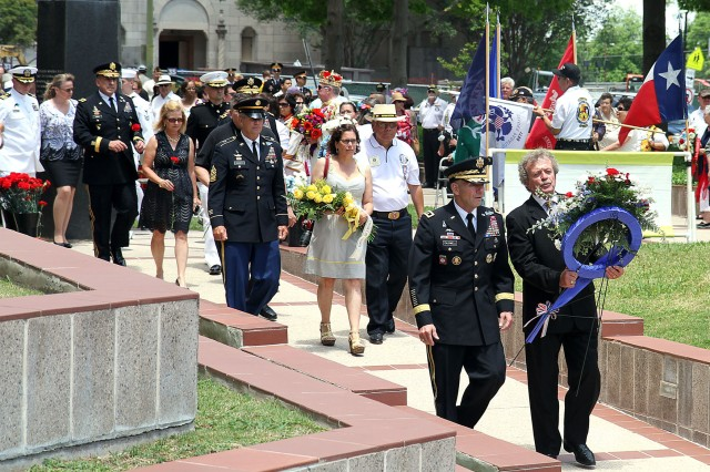 "FORT SAM HOUSTON, Texas "" Lt. Gen. William Caldwell IV and James Fenimore lead a procession as they prepare to place a wreath at the base of the Vietnam Memorial during the All Veterans Memorial Service April 28 in San Antonio. Caldwell, the commanding general of U.S. Army North (Fifth Army) and senior commander for Fort Sam Houston and Camp Bullis, served as the event's guest speaker. Fenimore is the commissioner for Vietnam Veterans of America and served as the master of ceremonies. The memorial service honors veterans "" both past and present."