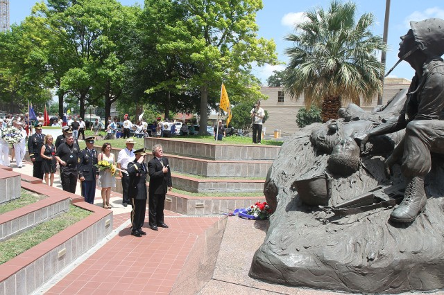 "FORT SAM HOUSTON, Texas "" Lt. Gen. William Caldwell IV and James Fenimore pay their respect after placing a wreath at the base of the Vietnam Memorial during the All Veterans Memorial Service April 28 in San Antonio. Caldwell, the commanding general of U.S. Army North (Fifth Army) and senior commander for Fort Sam Houston and Camp Bullis, served as the event's guest speaker. Fenimore is the commissioner for Vietnam Veterans of America and served as the master of ceremonies. The memorial service honors both past and present veterans."