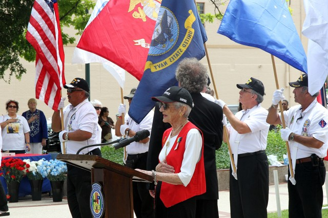 Anne Collins, a Marine Corps veteran from World War II, leads those in attendance in the Pledge of Allegiance April 28 during the All Veterans Memorial Service in San Antonio. The memorial service honors both past and present veterans. At the conclusion of the ceremony, military and civilian community members placed wreaths, bouquets and flowers at the base of the Vietnam Memorial in memory of those who have served.