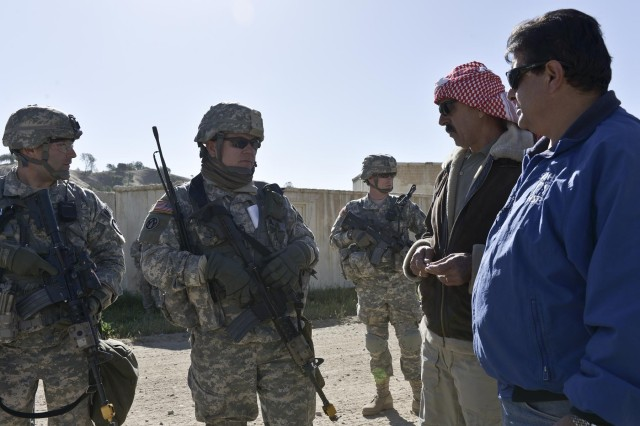(l-r) The 2nd Lt. Mathew Wisniewski, 339th Military Police Company 2nd Platoon Leader and Sfc. Christopher Walters, 339th Military Police Company 2nd Platoon Sergeant speak with a roll player acting as a village mayor and his translator (blue jacket) as Sgt. Nathan Anderson, 2nd Platoon, 2nd Squad leader stands watch. The 339th is attending CSTX 91 13-01 acting out notional scenarios based on real world activities.  Roll players act as foreign nationals dealing with transnational issues during the exercise. The Combat Support Training Exercise 91 13-01 is planned and coordinated by the 91st Training Division (Operations) at Fort Hunter Liggett, Calif.  CSTX gives participating units and opportunity to rehearse military maneuvers and tactics such as base security, convoy operations, and battle reaction drills during simulated enemy attacks as well as apply their Military Occupational Specialty skills in a theater of operations.  The exercise provides realistic training to units to successfully meet the challenges of an extended and integrated battlefield.