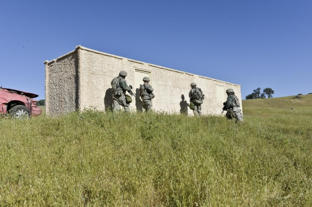 The 339th Military Police Company's 2nd Platoon, 2nd Squads Sgt. Nathan Anderson , Pfc. Elaina Johnson, Spc. Jason Johnson, and Sgt. Steven M. Springer are performing a building search during a mission.  The 339th is attending CSTX 91 13-01 acting out notional scenarios based on real world activities. The Combat Support Training Exercise 91 13-01 is planned and coordinated by the 91st Training Division (Operations) at Fort Hunter Liggett, Calif.  CSTX gives participating units and opportunity to rehearse military maneuvers and tactics such as base security, convoy operations, and battle reaction drills during simulated enemy attacks as well as apply their Military Occupational Specialty skills in a theater of operations.  The exercise provides realistic training to units to successfully meet the challenges of an extended and integrated battlefield.