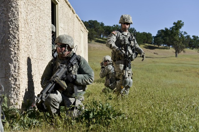 Sgt. Nathan Anderson (standing), 339th Military Police Company's 2nd Platoon, 2nd Squad leader, and Pfc. Elaina Johnson exit a building after performing a building search during a mission while Spc. Jason Johnson(front) and Sgt. Steven M. Springer (rear) stand guard.  The 339th is attending CSTX 91 13-01 acting out notional scenarios based on real world activities. The Combat Support Training Exercise 91 13-01 is planned and coordinated by the 91st Training Division (Operations) at Fort Hunter Liggett, Calif.  CSTX gives participating units and opportunity to rehearse military maneuvers and tactics such as base security, convoy operations, and battle reaction drills during simulated enemy attacks as well as apply their Military Occupational Specialty skills in a theater of operations.  The exercise provides realistic training to units to successfully meet the challenges of an extended and integrated battlefield.