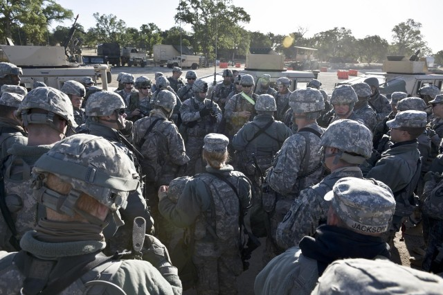 The 339th Military Police Company Commander, Capt. John Michael Burmon (center), holds a convoy brief with his soldiers before departing on a scheduled cordon and search mission at CSTX 91 13-01. The Combat Support Training Exercise 91 13-01 is planned and coordinated by the 91st Training Division (Operations) at Fort Hunter Liggett, Calif.  CSTX gives participating units and opportunity to rehearse military maneuvers and tactics such as base security, convoy operations, and battle reaction drills during simulated enemy attacks as well as apply their Military Occupational Specialty skills in a theater of operations.  The exercise provides realistic training to units to successfully meet the challenges of an extended and integrated battlefield.