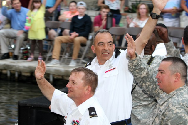 "SAN ANTONIO "" Col Richard Francey, along with his fellow Fort Sam Houston leaders, waves from the ""Fort Sam Houston"" float April 22 during the annual Texas Cavaliers River Parade in downtown San Antonio. The theme for this year's event was ""Stars on the River."" The parade is one of key events during Fiesta San Antonio and dates back to 1941. It runs along the River Walk in downtown San Antonio. Francey serves as the chief of staff for U.S. Army North (Fifth Army)."