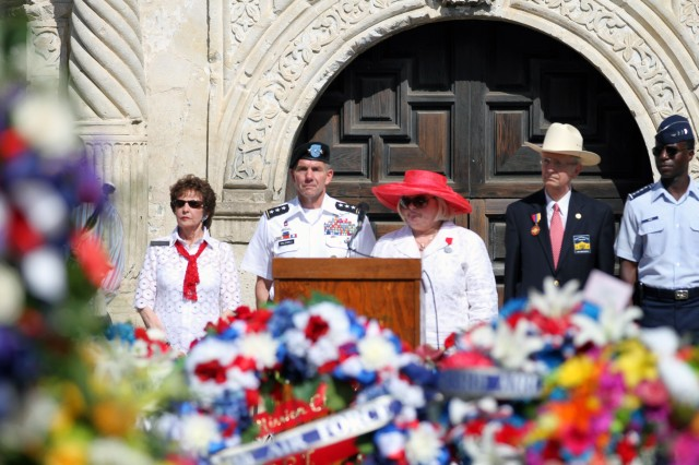 """FORT SAM HOUSTON, Texas """" Military and community leaders stand in remembrance April 22 of the sacrifices made by the men who died in defense of the Alamo during the annual Pilgrimage to the Alamo, one of the more somber events of Fiesta. Fiesta is an 11-day celebration across San Antonio. It features more than 100 different events focusing on the vibrant culture and rich history of the city."""