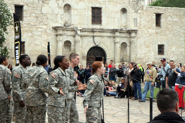 "SAN ANTONIO "" Members of the Soldier Show belt out the tunes in front of the Alamo as San Antonio community members enjoy the performance April 24. The cast of the U.S. Army Soldier Show, followed by a quintet from the 323rd Army Band ""Fort Sam's Own,"" displayed their creative talents for the community during Army Day at the Alamo, which is one of the unique events during Fiesta San Antonio."