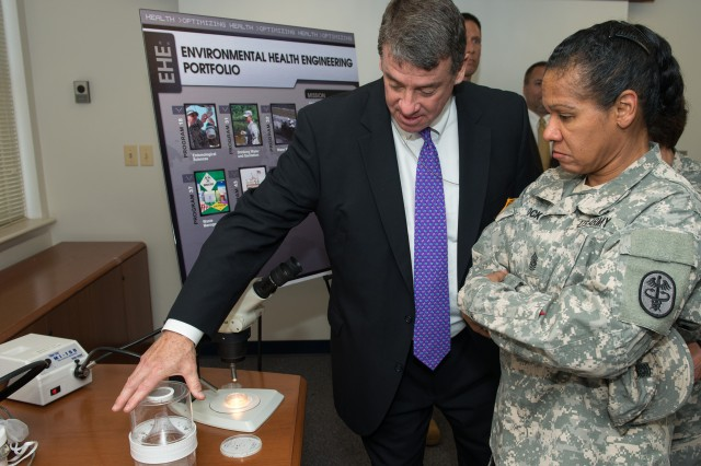 John Resta, director of the USAPHC's Army Institute of Public Health, explains to MEDCOM Command Sgt. Maj. Donna Brock how mosquitoes and other disease vectors are captured using a light trap. By identifying what types of mosquitoes and other disease vectors are present, entomologists can determine the control measures needed to protect Soldiers.