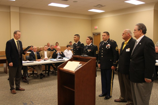 Washington County, Tenn. Mayor Dan Eldridge reads a proclamation before the county council commemorating the 105th birthday of the Army Reserve on April 22 in Jonesborough, Tenn. Present were Soldiers of the 702nd Engineer Company out of Gray, Tenn., 1st Lt. Vinh Dao, Sgt. 1st Class Lynette Blair and Staff Sgt. Joseph Martinez. Also pictured are Ernie Rimsby of the Military Affairs Council and Army Reserve Ambassador for Tennessee John Dyess.