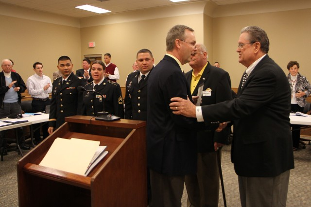"Army Reserve Ambassador for Tennessee John Dyess thanks the Mayor of Washington County, Tenn. in Jonesborough for reading a proclamation commemorating the 105th birthday of the Army Reserve and the importance of the warrior citizen. ""A good job done by anybody needs to be recognized, and service to this nation is more important, I think now, than ever,"" Dyess said. ""And these people who willingly put on this nation's uniform and go in harm's way for me, my family, yours and our way of life deserve our faith."" Also pictured are, from left to right, 1st Lt. Vinh Dao, Sgt. 1st Class Lynette Blair, Staff Sgt. Joseph Martinez of the 702nd Engineer Company and Ernie Rumsby, president of the Tri-Cities Military Affairs Council. The Army Reserve originally started as the Medical Reserve Corps in 1908, but became an active military branch after World War I. The mission of the US Army Reserve is to provide trained, equipped and ready soldiers but also to help with aid after natural disasters and with civil support. Today, more than 200,000 Americans are enlisted in the Army Reserve ready for combat when called upon."